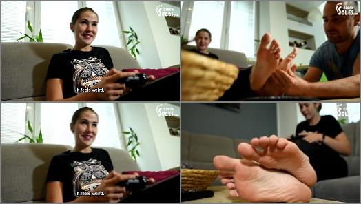 Foot Licking – 'College girl plays video games as her feet get worshiped ' of 'Czech Soles ' studio
