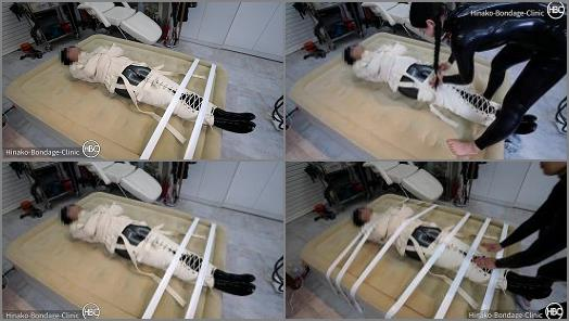 Hinako Bondage Clinic  Taped Down to the Bed in a Latex Cat Suit and Canvas Straitjacket preview